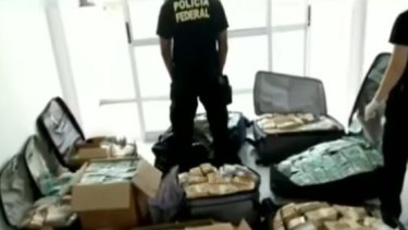Suitcases full of cash were found in an apartment used by former Brazilian presidential aid Geddel Vieira Lima.