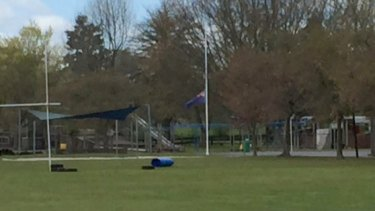 A flag iflies at half-mast at Reporoa Primary School in memory of Connor Brian Phillips, 11.