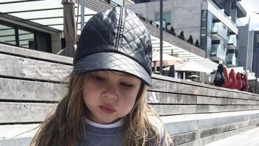 Four-year-old Riley Freeman (with a mouth full of marshmallows) models the label's minimalist fashion.