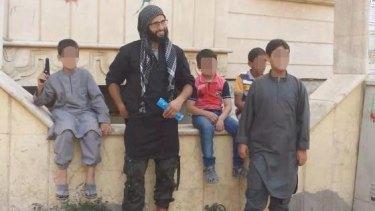 Mahmoud Abdullatif poses with children in Syria.