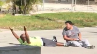 Charles Kinsey and the young autistic man moments before the police fired.