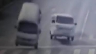 Vehicles appear to levitate in this screen grab from a video clip of a crash in China.