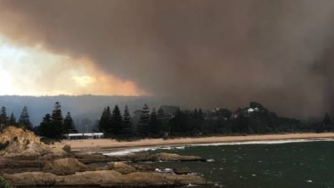 The bushfire is believed to have damaged or destroyed homes. Photo: David Porter