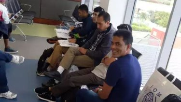 The refugees accepted for resettlement in the US in the departure lounge of Port Moresby airport.