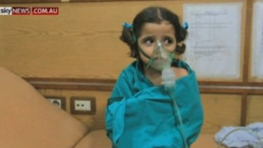 A young girl suffering the effects of a suspected gas attack in Aleppo this week.