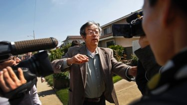 Is this bitcoin's creator? Journalists surround Satoshi Nakamoto as he walks from his home in Temple City.