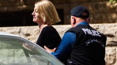 60 Minutes reporter Tara Brown escorted from court in Beirut on Monday.