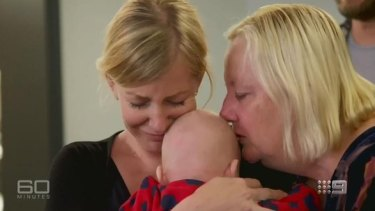 Sally Faulker is reunited with her baby, Eli, and her mother, Karen.