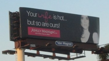 A promotional billboard for the Ashley Madison dating website.