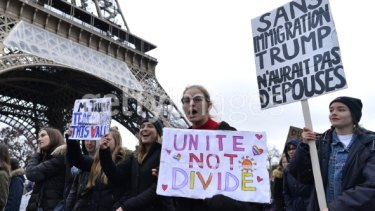 Anti-Trump protesters at the Eiffel Tower after the US president signed an executive order    banning immigration to the USA from seven Muslim-majority countries.