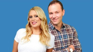 She's back ... Greig with breakfast co-host Travis Winks.