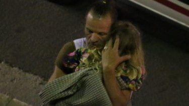 A man and child after a truck mowed down people during Bastille Day celebrations in Nice.