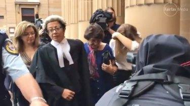 Judith Obeid, centre, leaves court after her husband Eddie was jailed.
