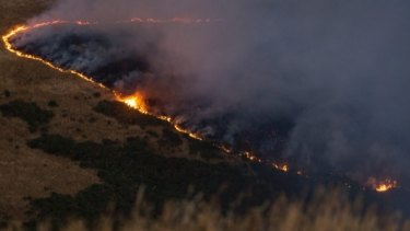A line of fire burns across the Port Hills, south of Christchurch, on Wednesday evening.