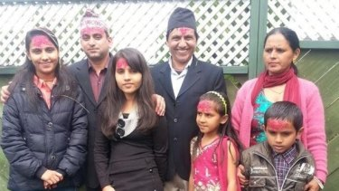 The Kafle family (left to right): Tulsa, 23, an unknown friend, Manisha, 16, Tej, Mamata, 12, Tika and Pram, 9.