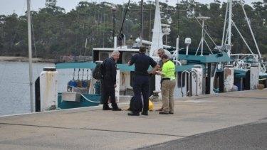 Alan Langdon speaks to Australian Border Force officials at Ulladulla Harbour.
