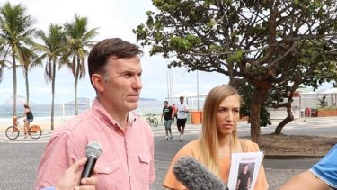 Rye Hunt's uncle Michael Wholohan and girlfriend Bonnie Cuthbert speaking with reporters in Rio de Janeiro.