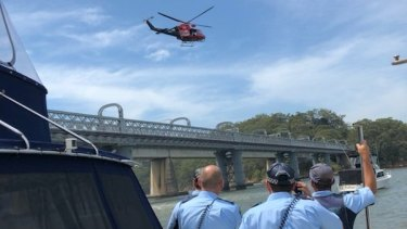 Police and a helicopter search the water at Como after a swimmer failed to resurface.