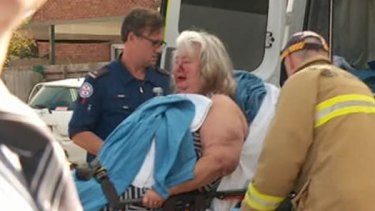 James Uhr's mother is treated by paramedics after her son allegedly attacked her.