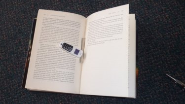 The phone discovered inside the spine of a book earlier this month.