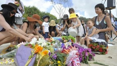 There was a large turnout at Shelly Beach on Saturday morning for the memorial service of local surfer Tadashi Nakahara who died in a shark attack at the popular surfing spot.