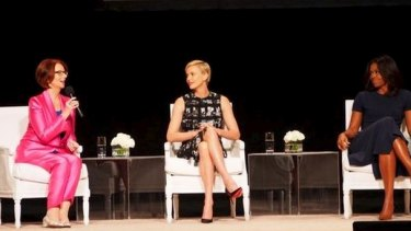 Julia Gillard discusses girls' education with Charlize Theron and Michelle Obama in September 2015.