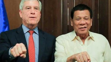 Australia's spy chief Nick Warner with Philippine president Rodrigo Duterte in Manila.