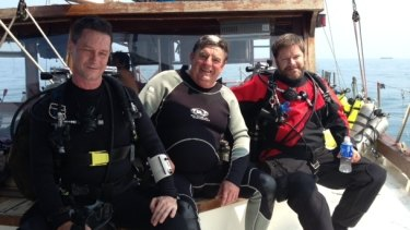 In the summer of 2013, Australian diver Frank Craven, (centre) was diving with a group on the wrecks of the USS Houston and HMAS Perth.