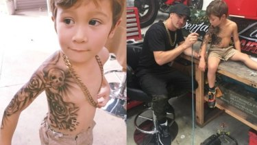 Benjamin Lloyd airbrushes a tattoo on a young boy.