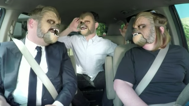 James Corden, JJ Abrams and Candace Payne don Chewbacca masks.