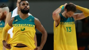 Patty Mills and David Andersen show their disappointment after missing out on an Olympic medal.