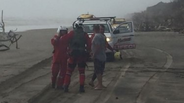 Rescue crews at the site of the Kaipara Harbour capsizing.