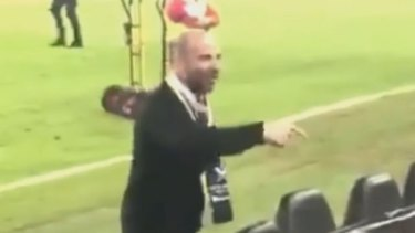 George Calombaris exchanges words with a fan at the A-League grand final on Sunday night.