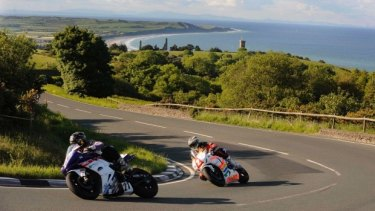 Practice laps for a TT Superbike race on the Isle of Man. The tiny self-governing island is considering giving up its roads to self-driving vehicles.