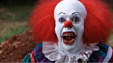 Tim Curry as Pennywise in the 1990 It miniseries.