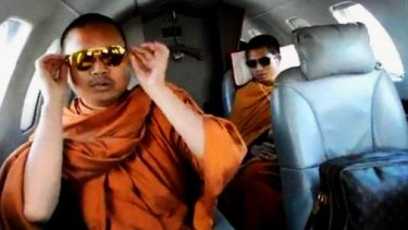 'Most monks are good monks, but there are exceptions': Wirapol Sukphol (left) during one of his frequent charter flights.