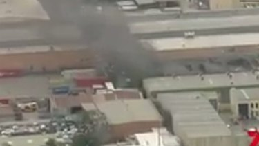 A fire has broken out at a car wrecking yard at Lansvale in Sydney's south-west.
