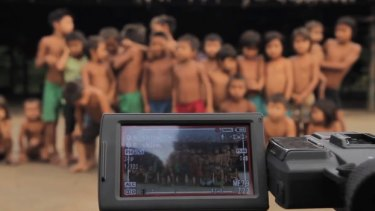 Yanomami children gather for a video shoot.