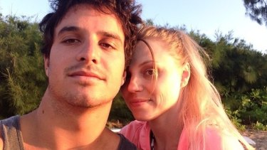 """'Smiling from ear to ear every day."""": Surfer Ricardo dos Santos poses with girlfriend Karol Esser."""