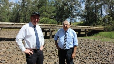 Deputy Prime Minister Barnaby Joyce inspected a bridge with state MP Thomas George following the helicopter flight to Drake.