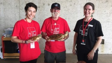 Bill Tomkins working alongside first time volunteer Margarita Sheliakina, and Queensland Museum's Katherine Griffin.