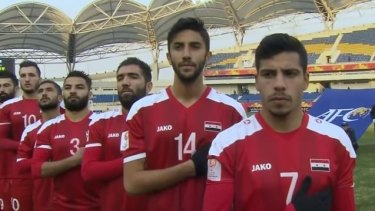 Ages queried: Syria line up for their opening game against the Olyroos in Kunshan.