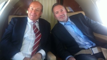 Former NewSat CEO Adrian Ballintine in corporate jet with the CFO of his yacht company, Jason Cullen.