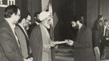 Kooshyar Karimi receives an award in Iran in 1994 for his achievements as a book translator.