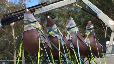 """The seven pears of Pear - version number 2 are being moved from their prime location at the front of the National Gallery of Australia in Canberra to make room for a new """"gravity-defying'' sculpture being unveiled soon."""
