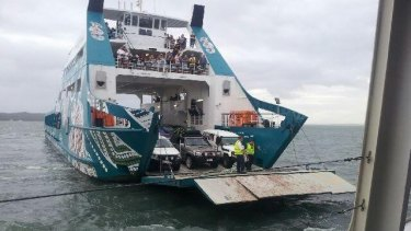 Stradbroke Ferries attempts to get passengers off its stranded Red Cat ferry.