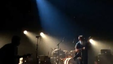 The drummer from the Eagles of Death Metal can be seen ducking behind his drum kit as shots were fired in the Bataclan.