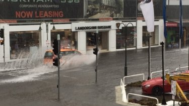 Motorists negotiate flash flooding at Fortitude Valley.