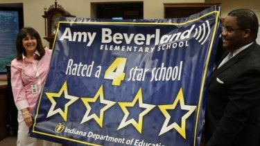 Susan Jordan unveiling a banner commemorating the school's rating by the Indiana Department of Education.