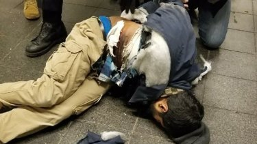Akayed Ullah in the moments after the explosion, which injured him only.